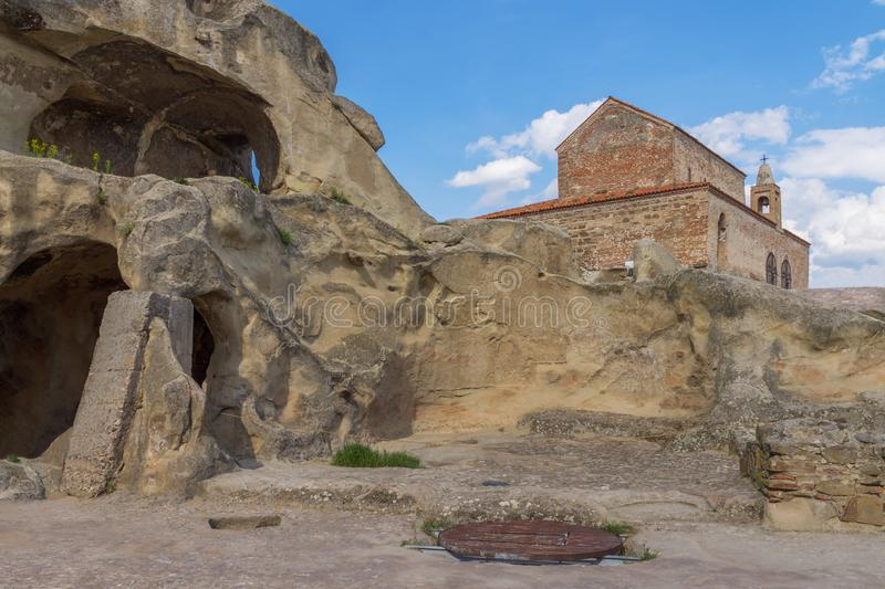 Ancient Rock-hewn town Uplistsikhe and Uplistsuli church . Georgia. Ancient Rock-hewn town Uplistsikhe. Georgia. Uplistsuli church or church of Prince. UNESCO stock image
