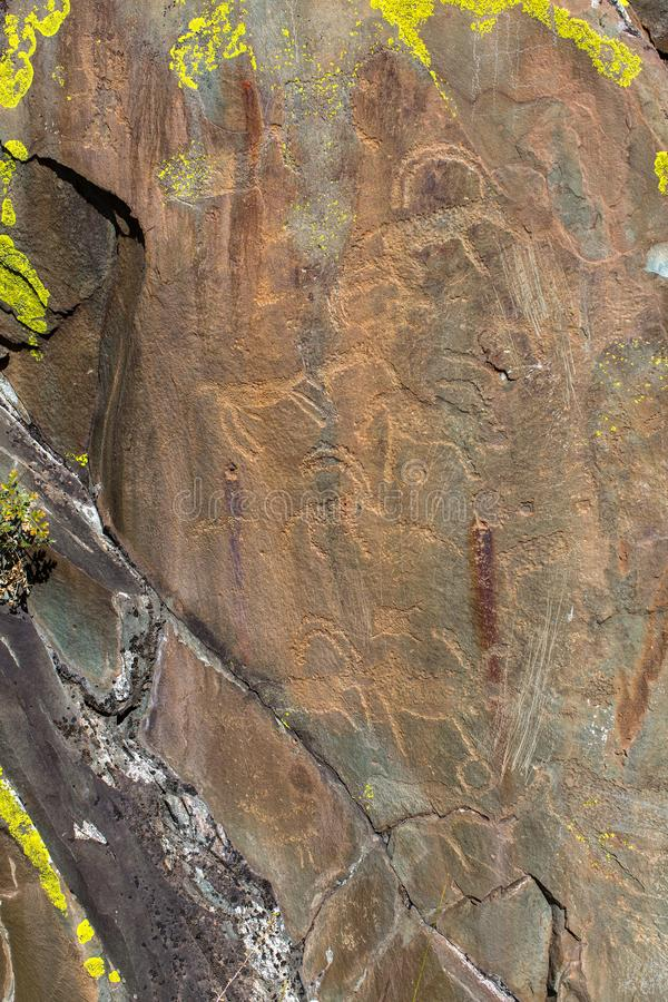 Ancient rock paintings Petroglyphs in the Altai Mountains stock images