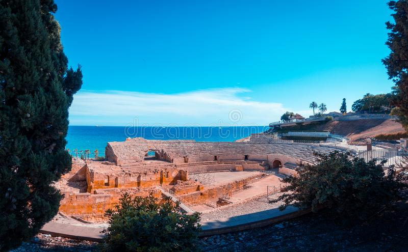 Roman amphitheatre in Tarragona, Costa Dorada, Catalonia, Spain, teal and orange view. Ancient roman amphitheater of Tarragona, Spain, next to the Mediterranean stock image