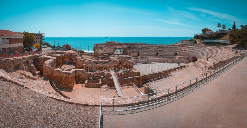 Roman amphitheatre in Tarragona, Costa Dorada, Catalonia, Spain, Panorama and teal and orange view. stock images