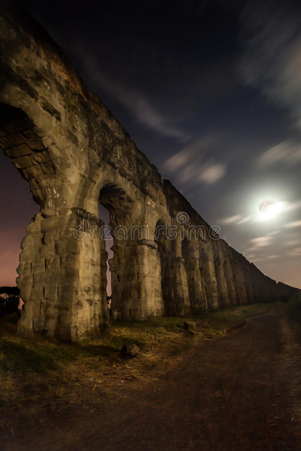 Ancient Roman Aqueduct. The Claudian aqueduct is the eighth in order of time, and it was one of the most important of ancient Rome. The construction of the royalty free stock photography