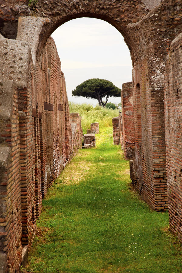 Ancient Roman Arch Ostia Antica Rome Italy. Ancient Roman Arch Walls Street Tree Ostia Antica Ruins Rome Italy Excavation of Ostia, ancient Roman port, next to royalty free stock images