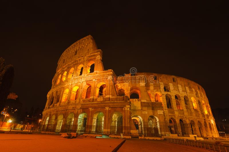 Ancient roman colosseum at dusk, Rome, Italy royalty free stock image