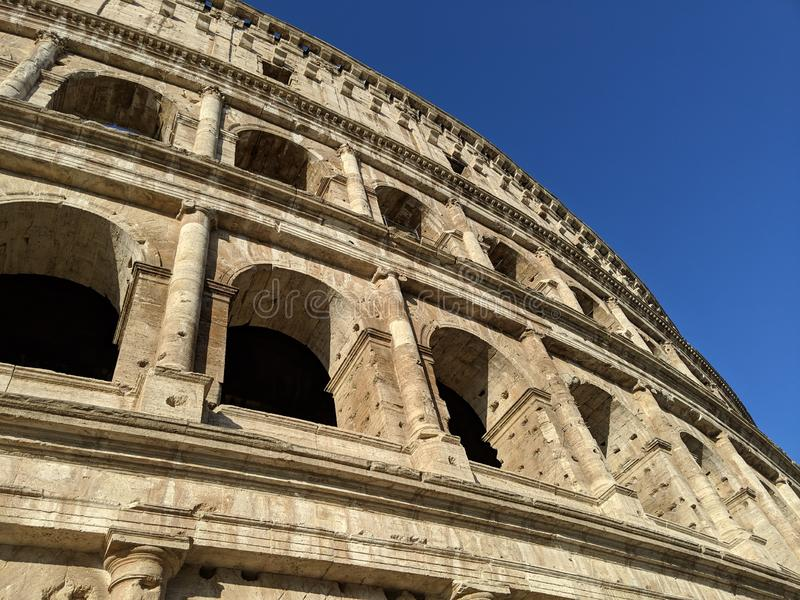 Ancient Roman Colosseum wall in the morning. With blue sky stock image