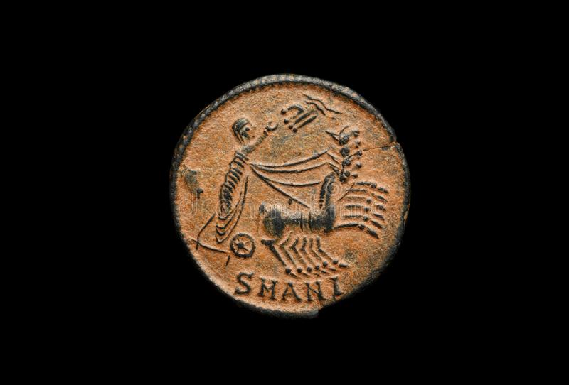 Ancient roman copper coin of emperor Constantine. Hand of god on the image royalty free stock photography
