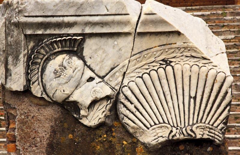Ancient Roman Decorations Helmet Ostia Antica Rome. Ancient Roman Decorations Helmet Ostia Antica Ruins Rome Italy Excavation of Ostia, ancient Roman port, next stock photography