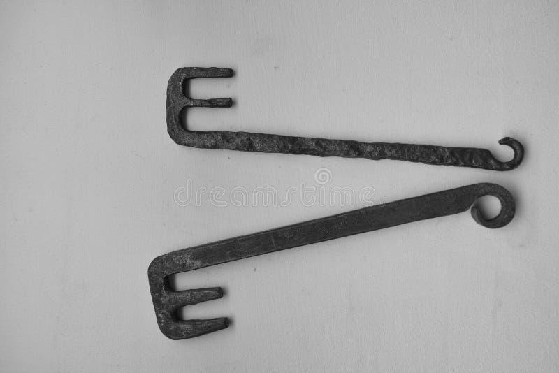 Ancient Roman iron door keys original and replica stock images