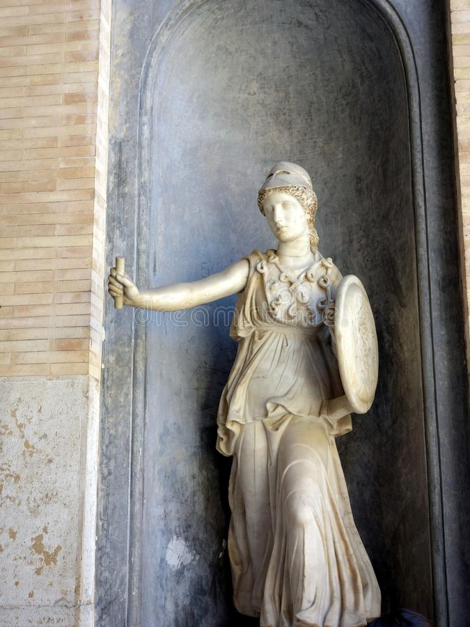 Female Warrior, Marble Statue, Vatican Museum. Ancient Roman marble statue of mythological female warrior with helmet, shield and breast plate armour, in the royalty free stock image