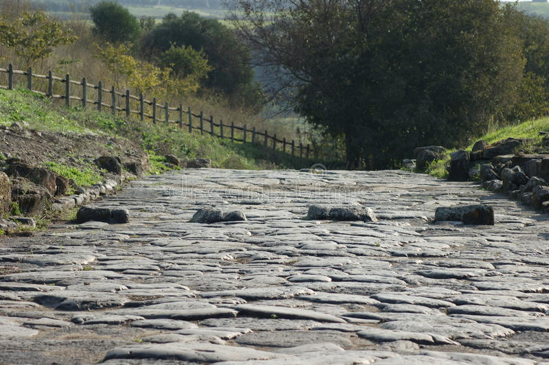 Ancient roman paved street with pedestrian crossing
