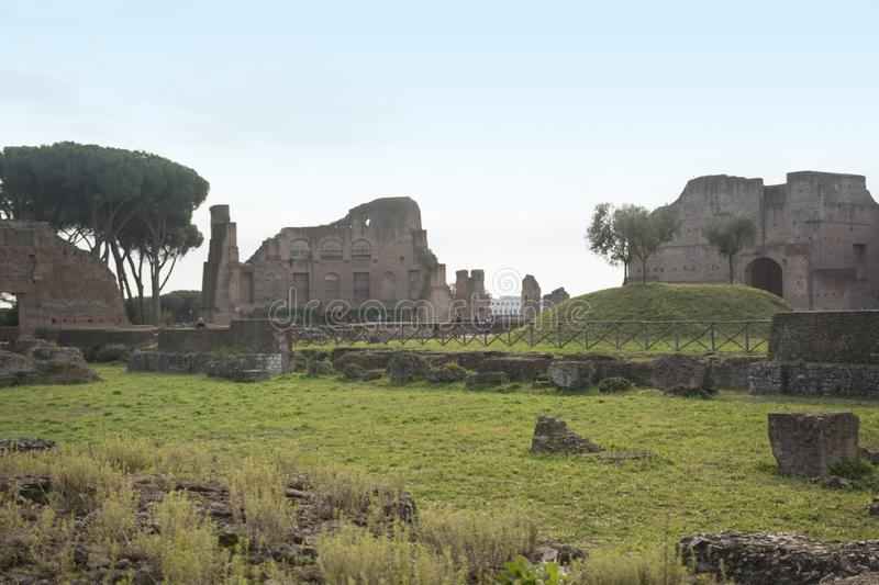 Ancient roman ruins at the Palatine Hill of Rome, Italy. Ancient roman architecture and landmark stock photo