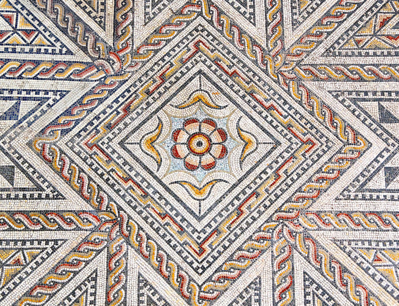 Ancient roman stone mosaic floor with geometric design royalty free stock photography