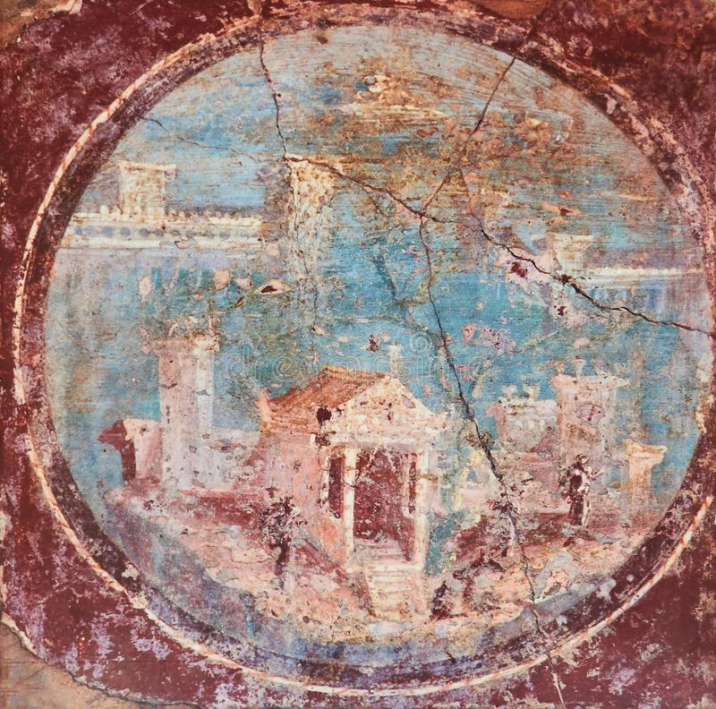 Ancient Roman villa in fresco on a red background in a Domus of Pompeii stock images