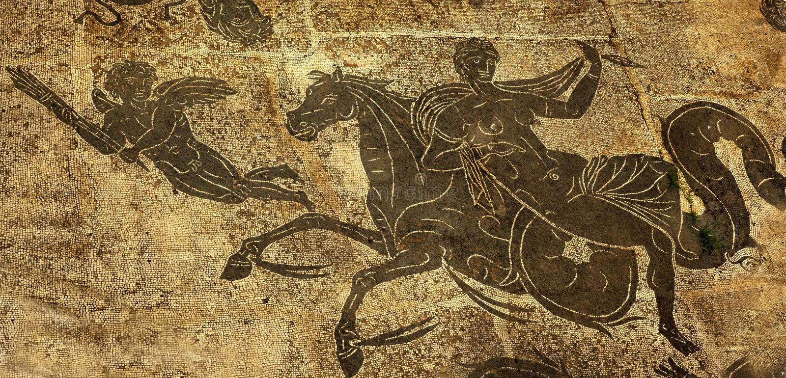 Ancient Roman Woman Horse Cupid Ostia Antica Rome. Ancient Roman Woman on Horse Cupid Mosaic Floors Baths of Neptune Ostia Antica Ruins Rome Italy Excavation of royalty free stock images