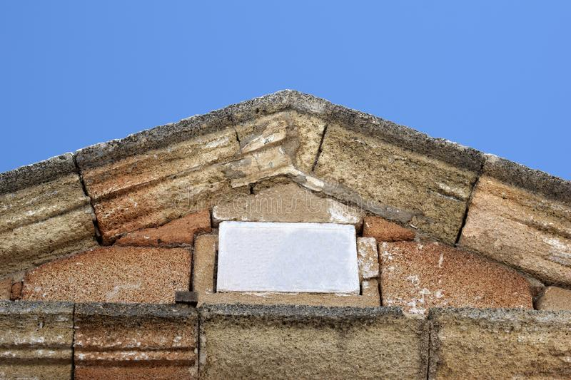 An ancient ancient roof with a blank white stone table stock images