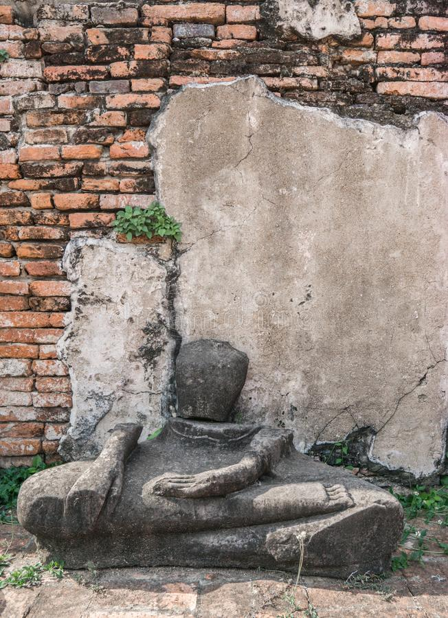 Ancient ruin of sitting buddha statue at old royal temple. royalty free stock images