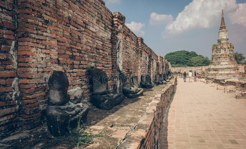 Ancient ruin of sitting buddha statue at old royal temple. stock photography