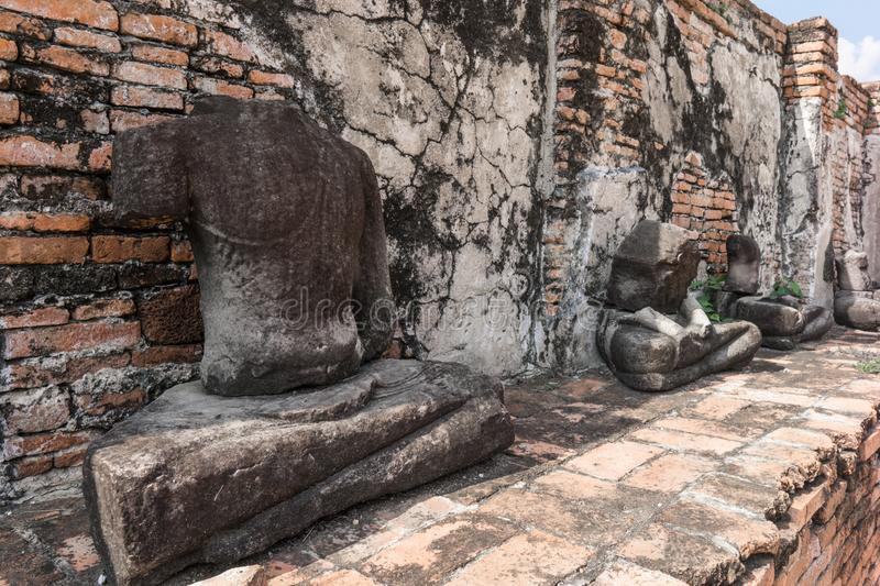 Ancient ruin of sitting buddha statue at old royal temple. stock images