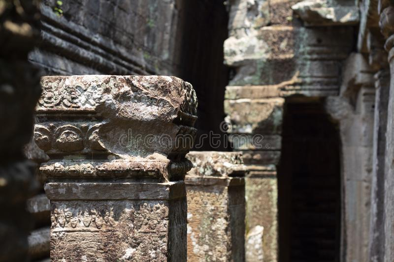 Ancient ruin of Ta Prohm temple, Angkor Wat complex, Siem Reap, Cambodia. Stone carving on pillar ruin. royalty free stock photo