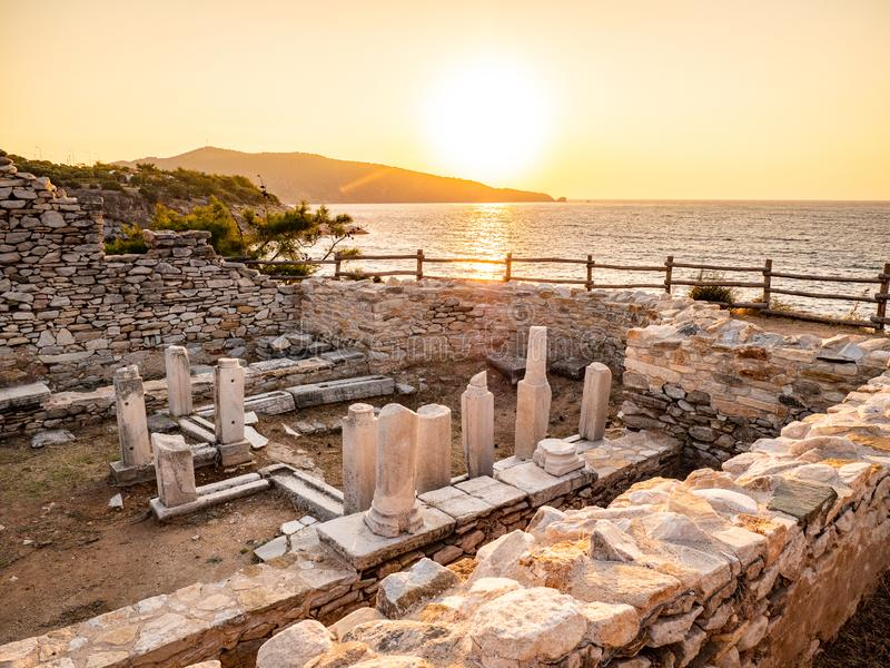 Ancient ruins at Aliki marble quarry in sunrise light, Thassos, Greece. Lens flare visible. Thasos or Thassos Island is a summer destination island in the royalty free stock image