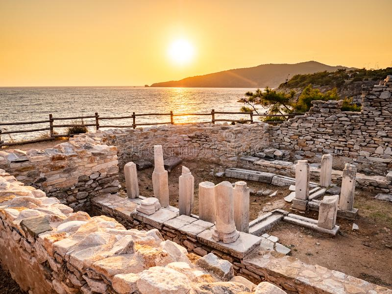 Ancient ruins at Aliki marble quarry in sunrise light, Thassos, Greece. Lens flare visible. Thasos or Thassos is an island in the Aegean Sea, close to the royalty free stock photography