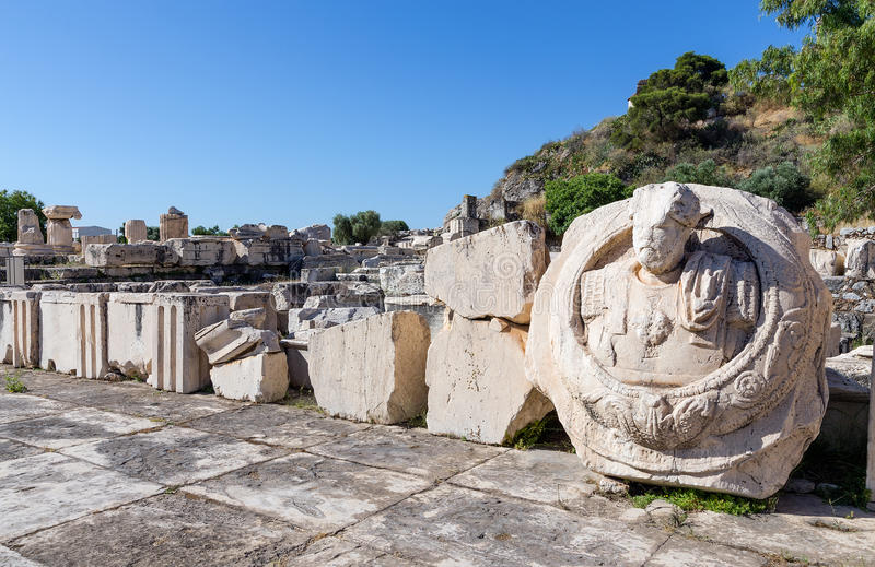 Ancient ruins of Eleusis, bust of Roman Emperor Marcus Aurelius in foreground, Attica, Greece royalty free stock image