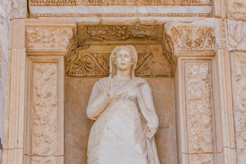 Ancient ruins at Ephesus historical ancient city. Personification of Virtue, Arete Statue in Ephesus historical ancient city, in Selcuk,Izmir,Turkey royalty free stock photos