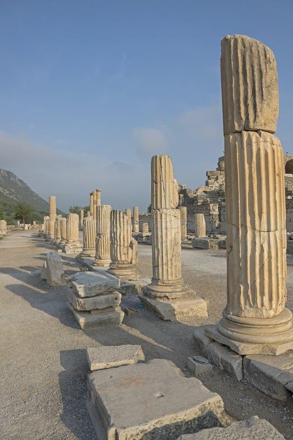 Ancient ruins at Ephesus in Turkey, pillars lining a walkway. stock photo