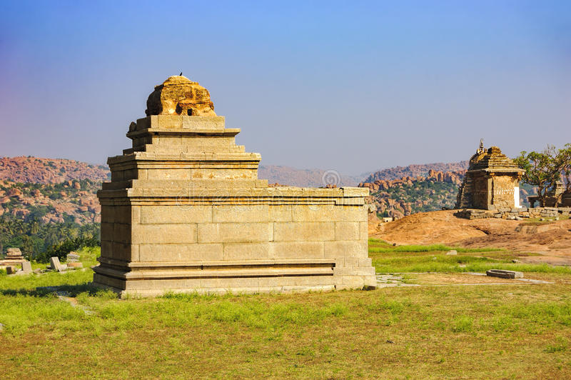 Ancient ruins on Hemakuta hill, Hampi, India. View of ancient ruins on Hemakuta hill in Hampi, Karnataka, India. Landscape with unique mountain formation with royalty free stock photos