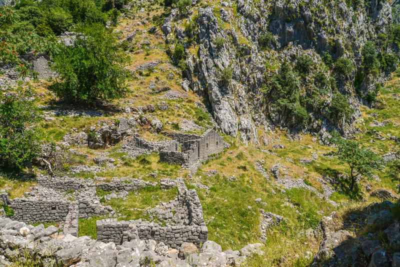 Ancient ruins and mountain valley landscape royalty free stock image