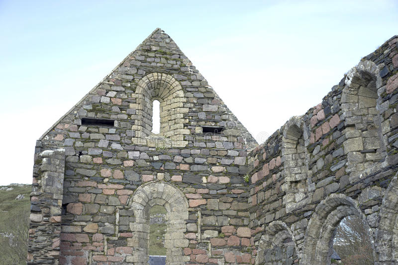 Ancient ruins pointing to heaven. This wall is part of the standing structure of the nunnery on the Isle of Iona. It can be visited while on walking tour of the royalty free stock image