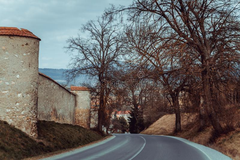 Ancient ruins in Slovakia. Beautiful road with trees. royalty free stock image