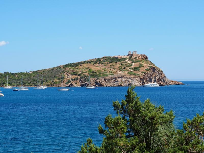 Temple of Poseidon at Cape Sounion. Ancient ruins of The Temple of Poseidon on top of the promontory at the southernmost point of Attica in Greece royalty free stock photography
