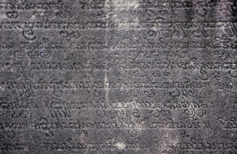 Ancient sanskrit text carved in stone royalty free stock photos