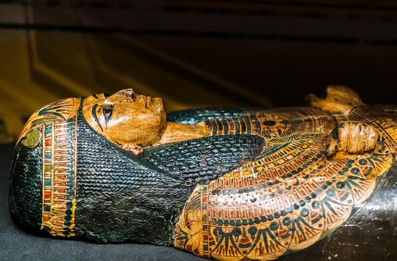 Ancient sarcophagus on display with a beautiful green and gold decoration. On display in Leeds - The sarcophagus is open and the top lies on it`s own so that the stock images
