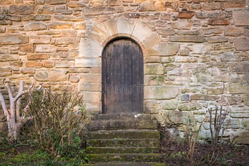 Ancient Scottish Castle Door. With medieval arches and studded door panels stock image