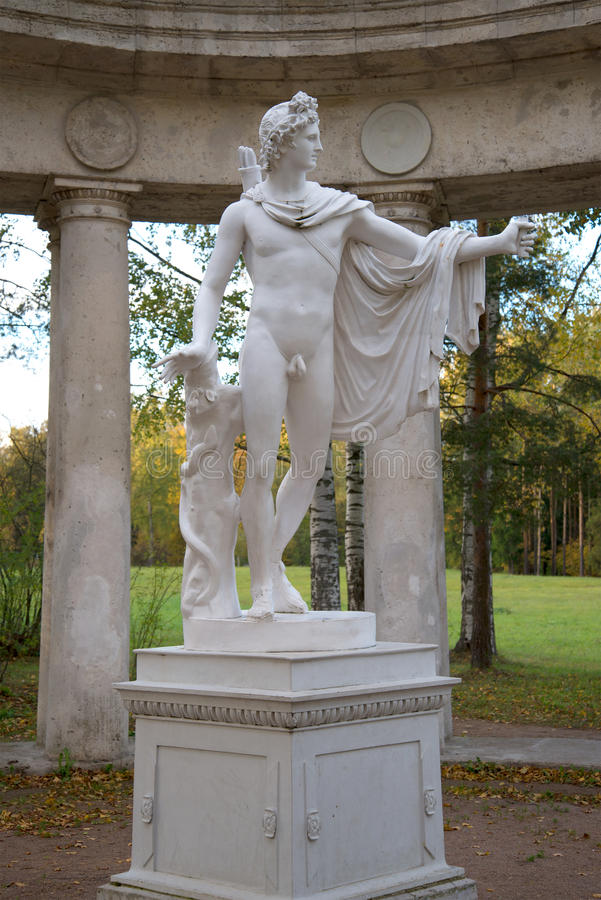 Ancient sculpture of Apollo in Pavlovsk palace park. October evening. Saint Petersburg royalty free stock image