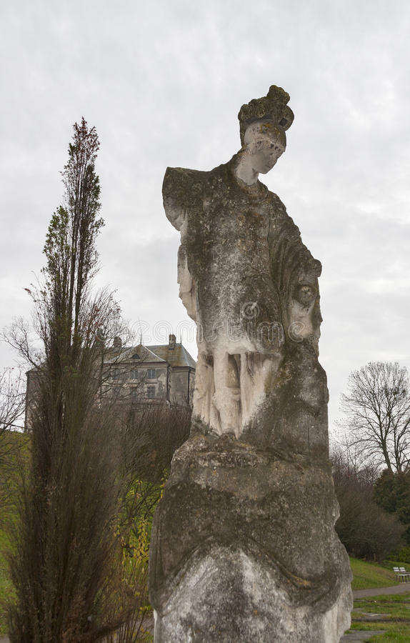 Ancient sculpture in Olesko castle park royalty free stock photo