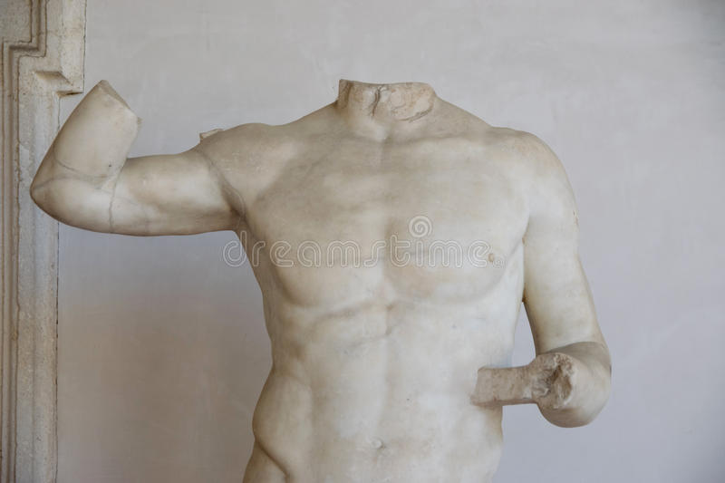 Ancient sculpture of a roman man in the baths of Diocletian. Ancient sculpture of the roman man in the baths of Diocletian Thermae Diocletiani in Rome. Italy royalty free stock photos