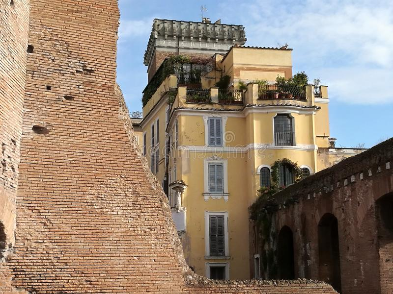 Ancient seventeen- century yellow building of the Grillo in the antique Trajan Markets  of Rome stock photo