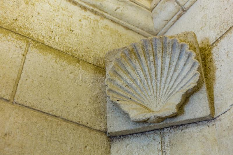 Ancient shell-shaped sculpture. Shell carved in a wall frieze stock photos