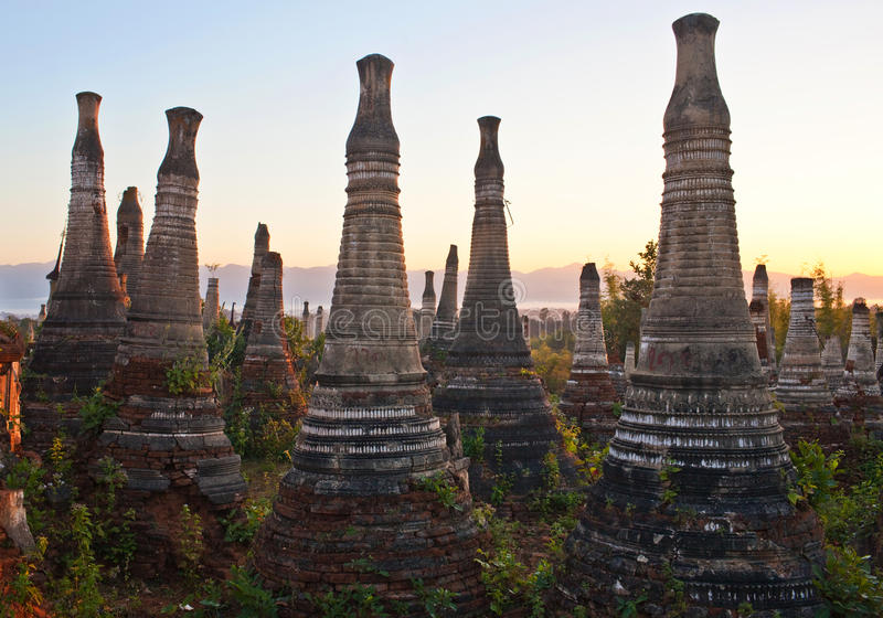 Ancient Shwe Inn Thein Pagoda in Myanmar. Ancient Shwe Inn Thein Pagoda, Inthein, Shan State, Myanmar. Weather-beaten buddhistic zedi constructed in 17th and royalty free stock photos