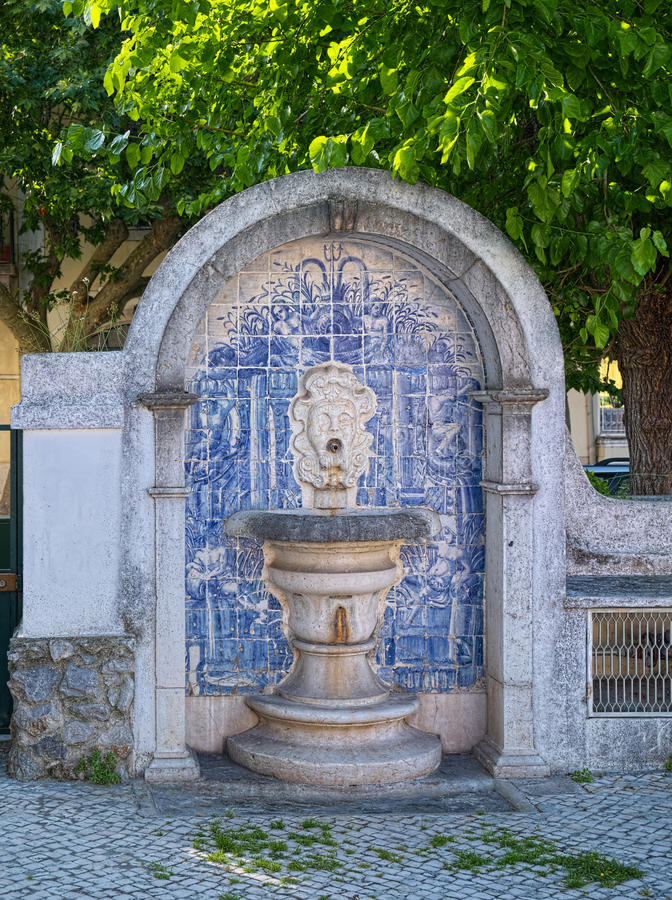 Ancient source of drinking water, Sintra, Portugal. The ancient public source of drinking water at street in the town of Sintra, Portugal. The source is framed stock photography