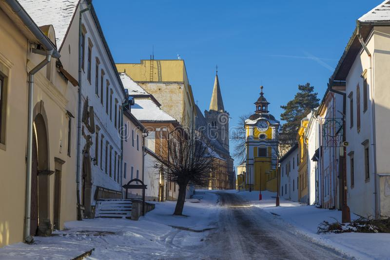 Ancient Spisska Kapitula, central street. Known as Slovak Vatican on background blue sky at winter. Spisske Podhradie, Slovakia, UNESCO World Heritage Site stock photography