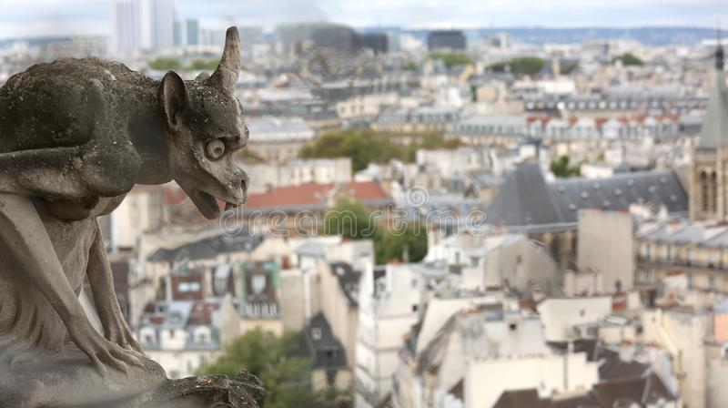 Ancient statue of a gargoyle in the church of Notre Dame. In Paris in France royalty free stock image