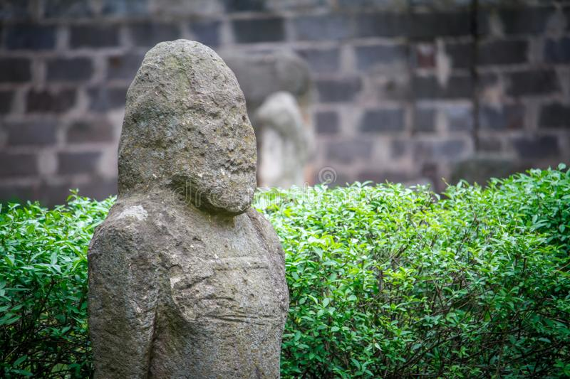 Ancient statue of Polovtsian stone woman or boundary stone in the city park royalty free stock photo