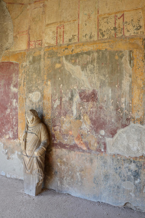 Ancient statue at the wall of the Stabian baths, Pompeii royalty free stock images