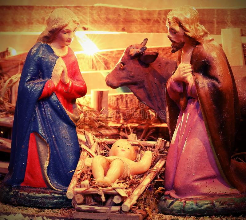 Ancient statues of Mary and Saint Joseph with baby Jesus in the royalty free stock photos