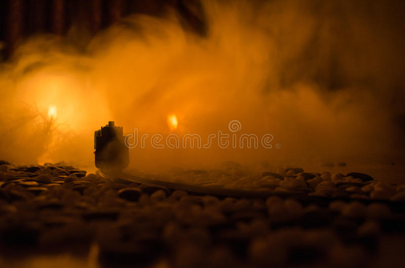 Ancient steam locomotive in night. Night train moving on railroad. orange fire background. Horror mystical scene stock photo
