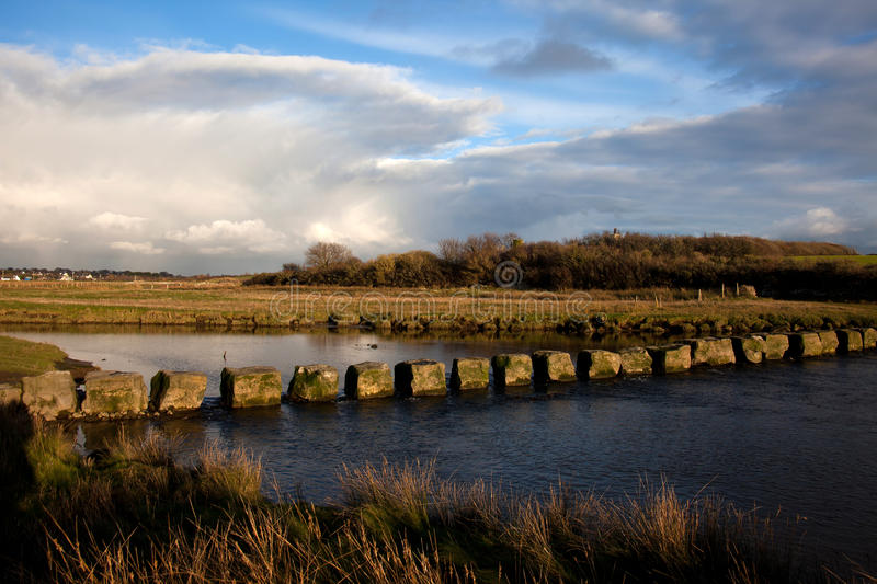 Ancient stepping stones. On Anglesey North Wales over a river royalty free stock image