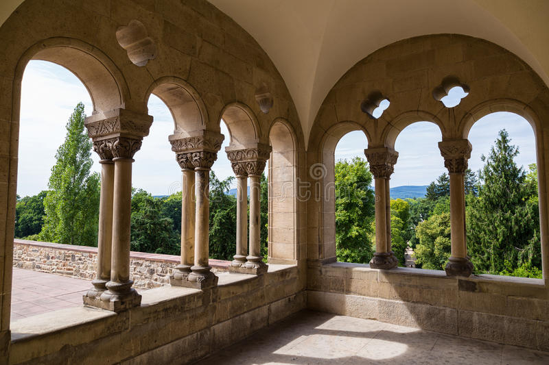 Ancient stone arch porch in palace. View of park in sunny summer day. Germany stock images